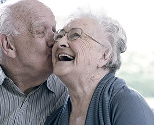 Old couple smiling and laughing together